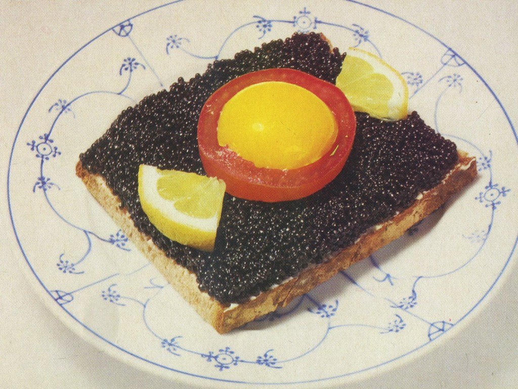 'Caviar bread how the Danish like it' - With a raw egg yolk placed inside of a tomato ring